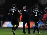 Norwich boss Chris Hughton with his players after victory over Swansea on December 8, 2012