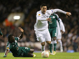 Tottenham's Clint Dempsey skips past Panathinaikos' Ibrahim Sissoko on December 6, 2012
