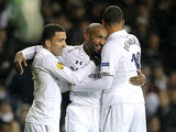 Tottenham Hotspur's Jermain Defoe is congratulated by team mate after scoring his team's third goal on December 6, 2012