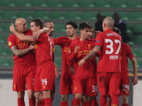 Liverpool team mates congratulate Jordan Henderson after scoring the opener on December 6, 2012