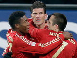 Bayern's Mario Gomez is congratulated by his team mates after scoring on December 8, 2012