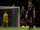A disappointed Steven Gerrard leaves the field at half-time after scoring an own goal on December 9, 2012