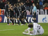 Bayern's Thomas Muller is congratulated upon scoring on December 5, 2012