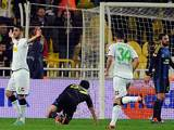 Borussia Moenchengladbach's Tolga Cigerci celebrates moments after netting a goal against Fenerbahce on December 6, 2012