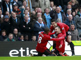 Wayne Rooney celebrates his goal with team mates Ashley Young and Robin Van Persie on December 9, 2012