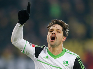 Wolfsburg's Diego celebrates after converting a penalty on December 8, 2012