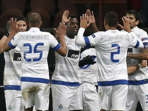Porto players celebrate Jackson Martinez's goal against PSG on December 4, 2012