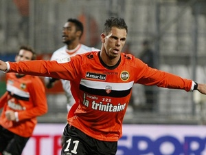 Lorient forward Jeremie Aliadiere celebrates a goal against Marseille on December 9, 2012