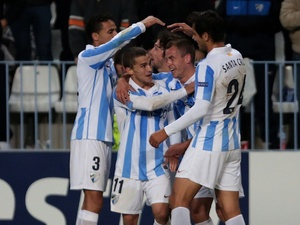 Malaga players celebrate their opening goal against Anderlecht on December 4, 2012