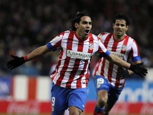 Atletico Madrid star Radamel Falcao celebrates his goal against Deportivo on December 9, 2012