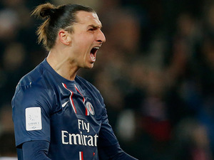 Paris Saint Germain's Zlatan Ibrahimovic celebrates after scoring the opener on December 8, 2012