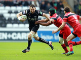 Ospreys' Joe Bearman attempts to get past Toulouse's Thierry Desautoir on December 15, 2012