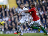 Kyle Walker and Wayne Routledge battle for the ball on December 16, 2012