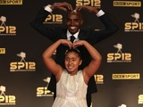 Mo Farah and his daughter do the 'Mobot' on the red carpet at Sports Personality of the Year on December 16, 2012