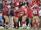 San Francisco 49ers players celebrate on December 9, 2012
