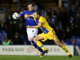 Stephen Caldwell and Glenn Murray battle for the ball on December 15, 2012