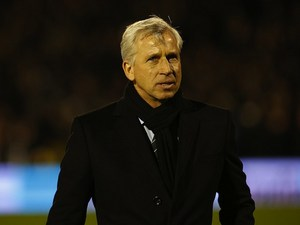 Magpies boss Alan Pardew wrapped up warm on December 10, 2012