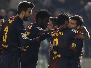 Messi is congratulated by teammates after his early Copa Del Rey strike against Cordoba on December 12, 2012