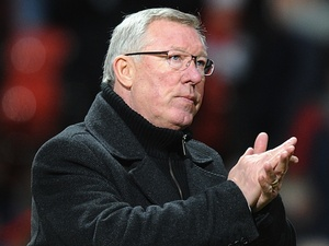 Man Utd boss Sir Alex Ferguson applauds his team after winning 3-1 against Sunderland on December 15, 2012