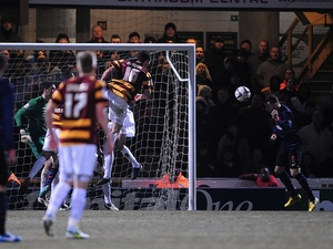 Arsenal captain Thomas Vermaelen scores a late equaliser against Bradford on December 11, 2012