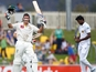 Australia's Michael Hussey celebrates a century on December 15, 2012