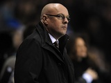 Reading boss Brian McDermott looking glum during a 5-2 loss to Arsenal on December 17, 2012
