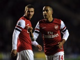 Striker Theo Walcott celebrates wrapping up the points for Arsenal against Reading December 17, 2012