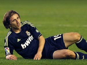 Real's Luka Modric lies on the turf in a game against Real Betis on November 24, 2012