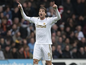 Swansea forward Michu celebrates his goal against Manchester United on December 23, 2012
