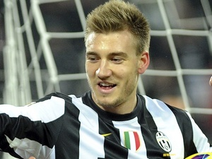 Juve loanee striker Nicklas Bendtner celebrates following a goal by Sebastian Giovinco on December 1, 2012