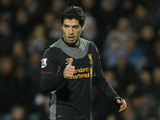 Luis Suarez gives the thumbs up after scoring his second goal against QPR on December 30, 2012