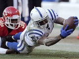 Colts WR Reggie Wayne scrambles for extra yardage against the Chiefs on December 23, 2012