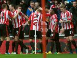 John O'Shea is congratulated by team mates after scoring the opener on December 29, 2012