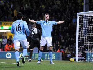 Edin Dzeko celebrates after scoring the opener against Norwich on December 29, 2012