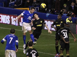 Everton defender Phil Jagielka heads home his team's second against Wigan on Boxing Day 2012