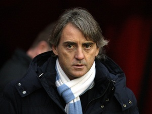 City boss Roberto Mancini in the dugout against Sunderland on Boxing Day 2012