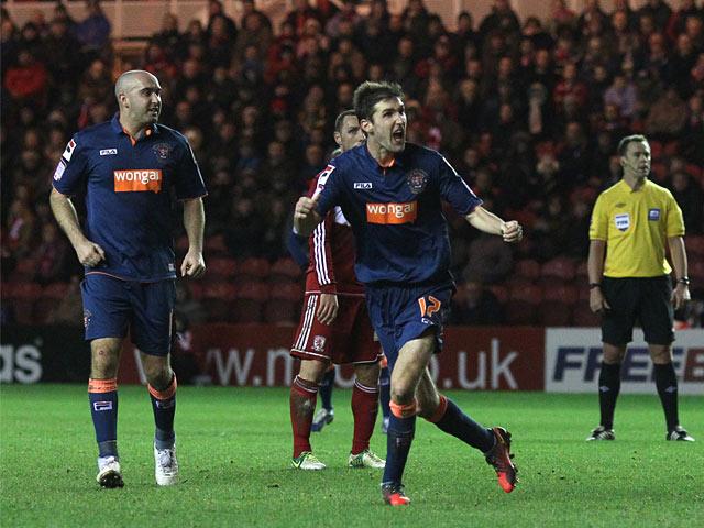 Blackpool's Chris Basham celebrates scoring his team's second goal on December 29, 2012