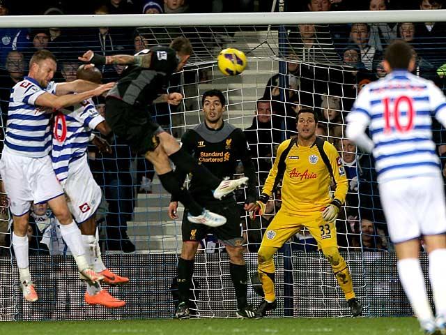 Daniel Agger heads in Liverpool's third goal against QPR on December 30, 2012