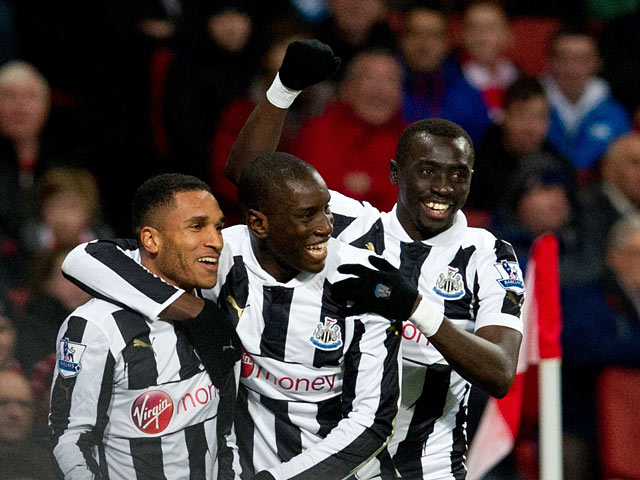 Demba Ba celebrates with team mates after scoring his first against Arsenal on December 29, 2012