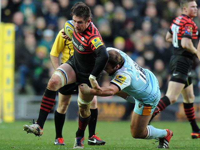 Northampton Saints' Paul Doran-Jones is tackled by Saracens' Ernst Joubert on December 30, 2012
