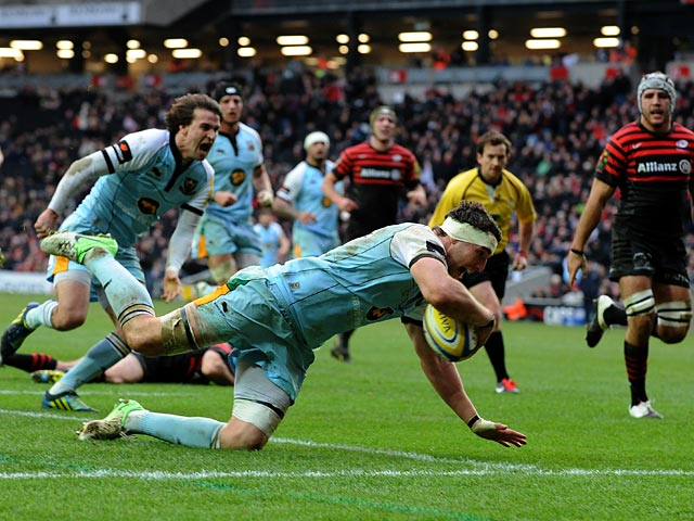 Northampton Saints' Phil Dowson scores the first try against Saracens on December 30, 2012