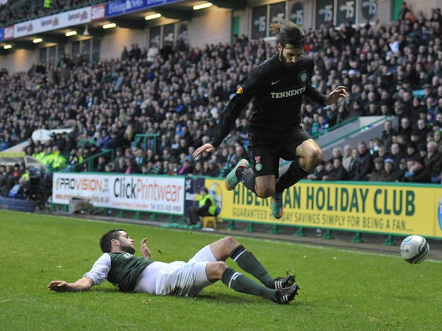 Hibernian's Tim Clancy slides in to win the ball from Celtic's Georgios Samaras on December 29, 2012