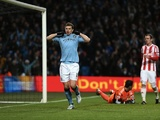 City striker Edin Dzeko celebrates their second goal against Stoke on January 1, 2013