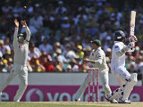 Australia's Michael Clarke catches a ball from Sri Lanka's Lahiru Thirimanne on January 3, 2013