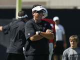 Greg Knapp of the Oakland Raiders watches a practice session on August 3, 2012