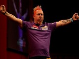 Peter Wright of Scotland celebrates defeating Simon Whitlock of Australia in their semi final match on day fifteen of the Ladbrokes.com World Darts Championship on December 30, 2013