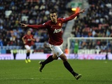 Man Utd striker Robin Van Persie celebrates his goal against Wigan on January 1, 2013