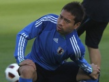 Japan's Yuto Nagamoto stretches during a training session in Qatar on January 6, 2011