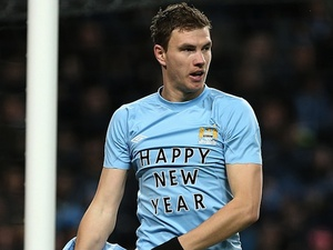 City striker Edin Dzeko sends a message to the fans in the game against Stoke on January 1, 2013
