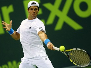 Fernando Verdasco in action against Felippo Volandri during their Qatar Open first round match on December 30, 2013